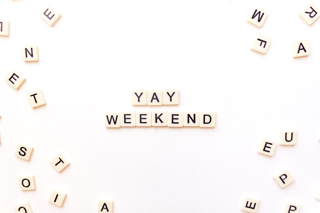 Yay weekend! Spelled out with Scrabble letters on white background. To illustrate more free time when hire a home cleaner