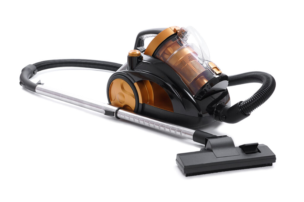 Bagless vacuum cleaner orange and black on white background