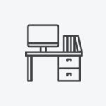 Desk with computerand books simplified icon in black and white on white background